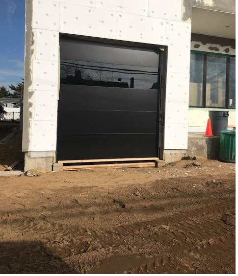 Infinity - Flush Panel Smooth Steel Garage Door with Horizontal Modern Glass Design