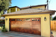 Noel - Spanish Style Custom Wood Garage Door