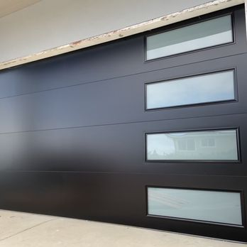 Novo - Smooth Flush Panel Steel Garage Door With Windows Modern Design