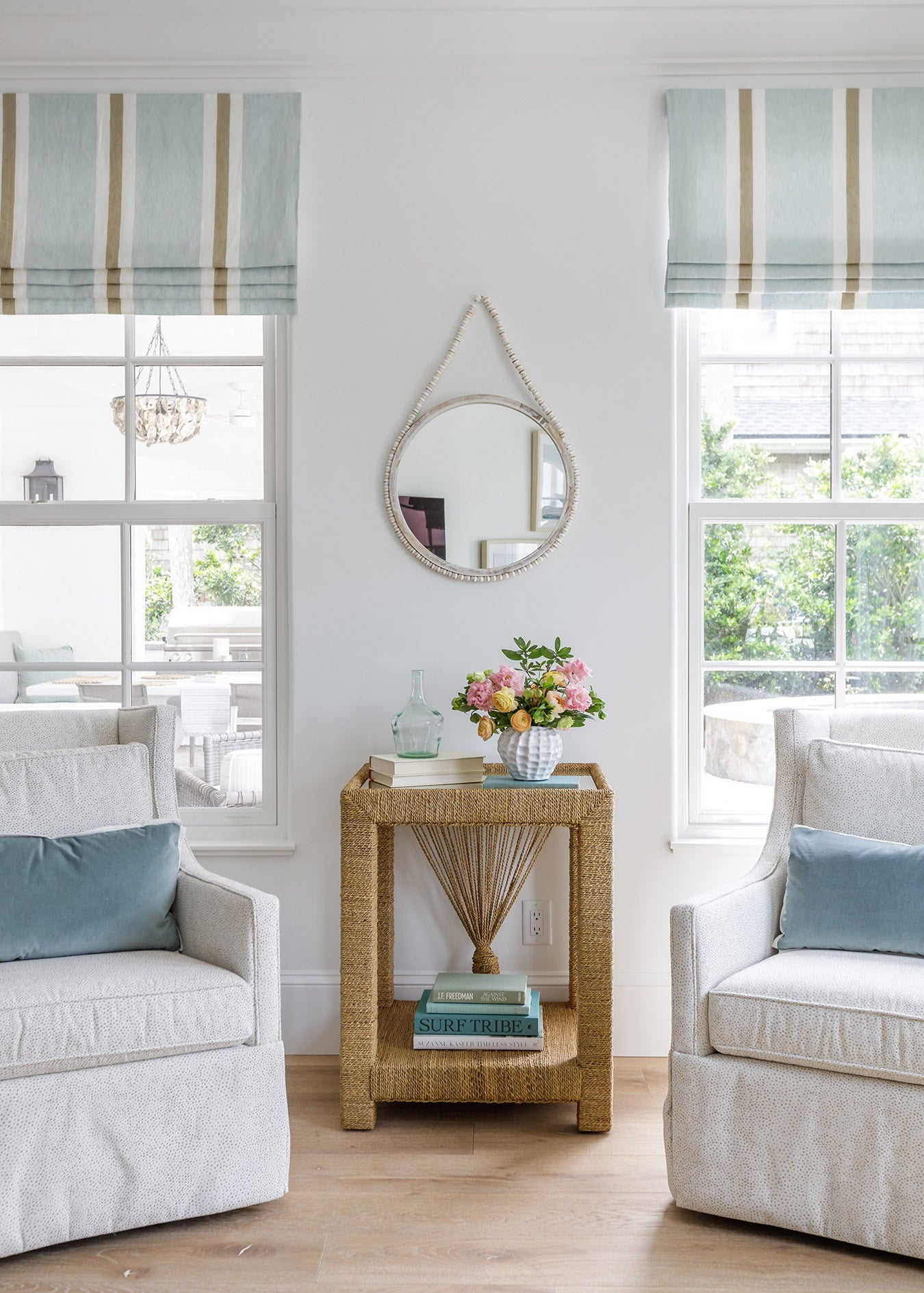 White chairs by windows designed by Nesting Place Interiors