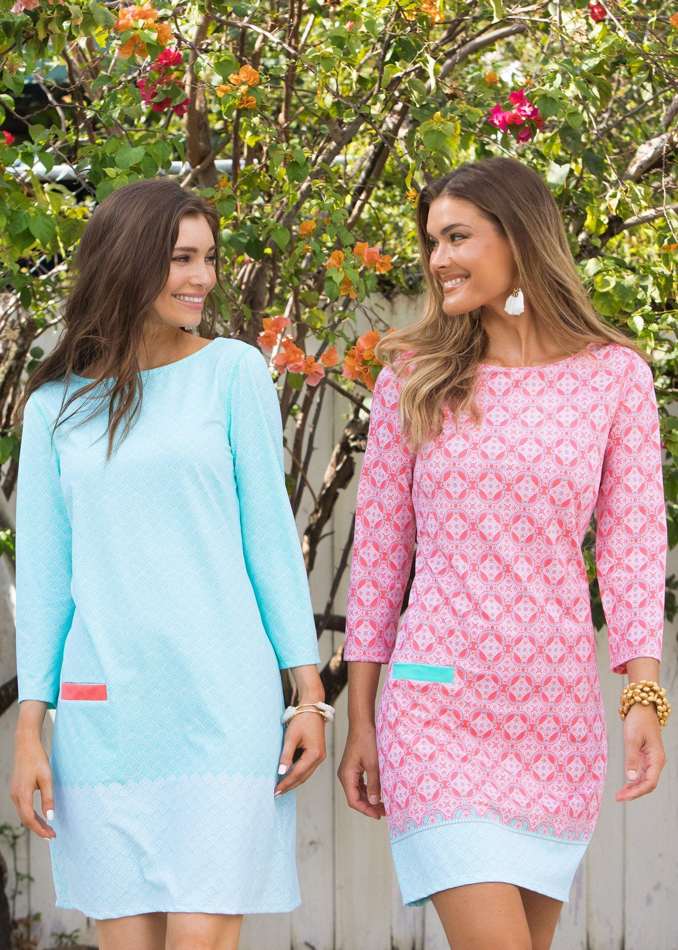 Two women in matching Cabana Life Coral Tides UPF 50+ Cabana Shift Dresses