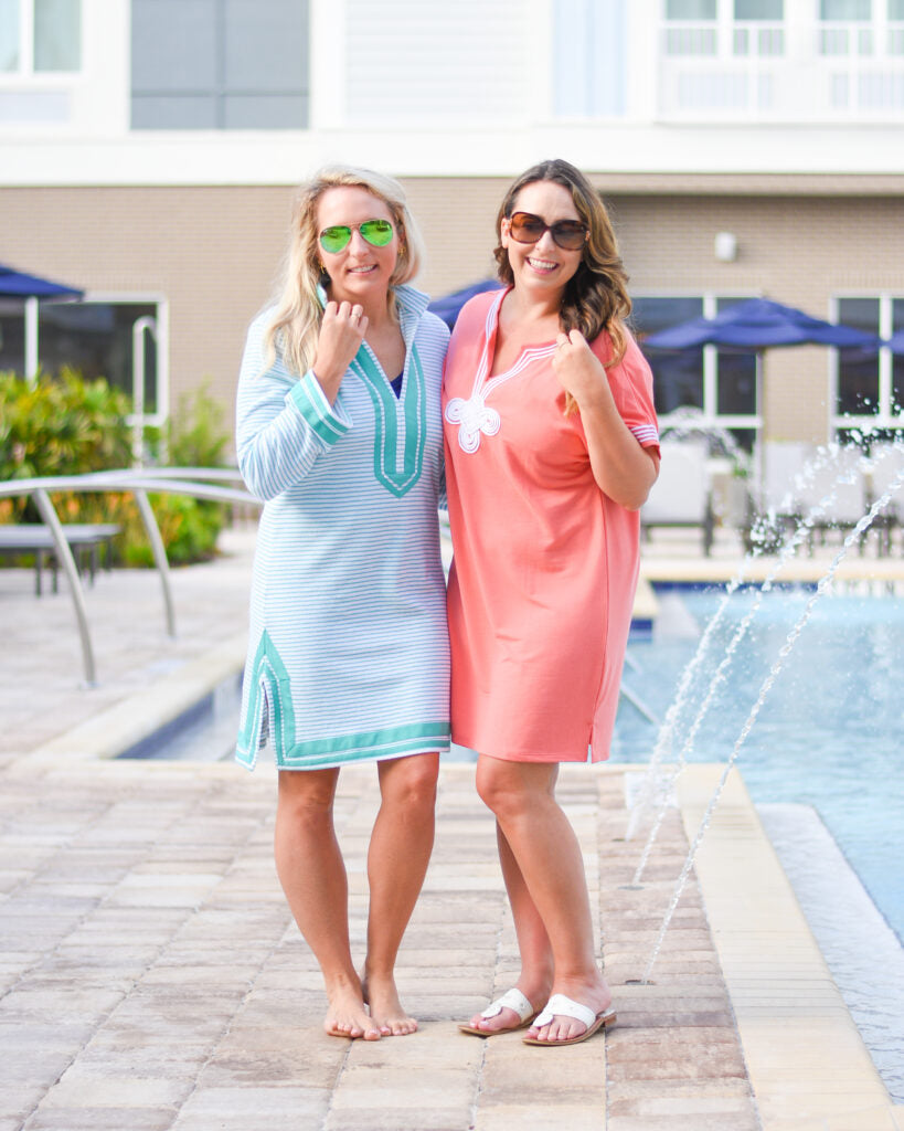 Two women wearing Cabana Life UPF 50+ Mint Stripe Terry Tunic and Coral Tee Dress