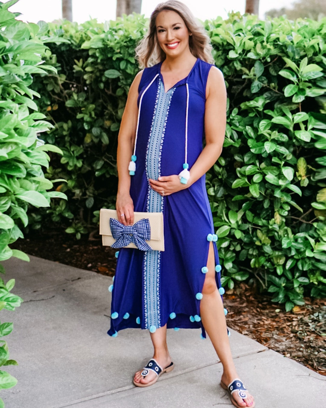 Woman standing in front of bushes wearing Cabana Life Aruba Blues Embroidered Maxi Dress