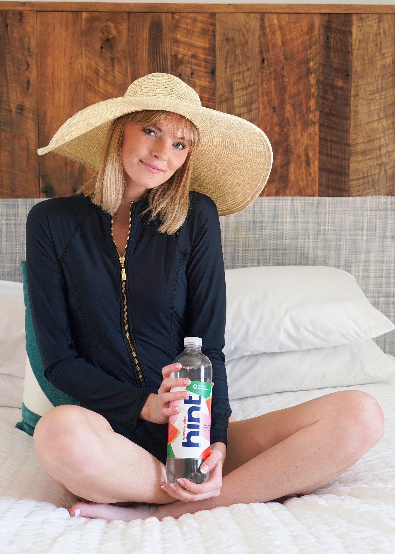 Cabana Life Black Unisuit with Hint Water on bed