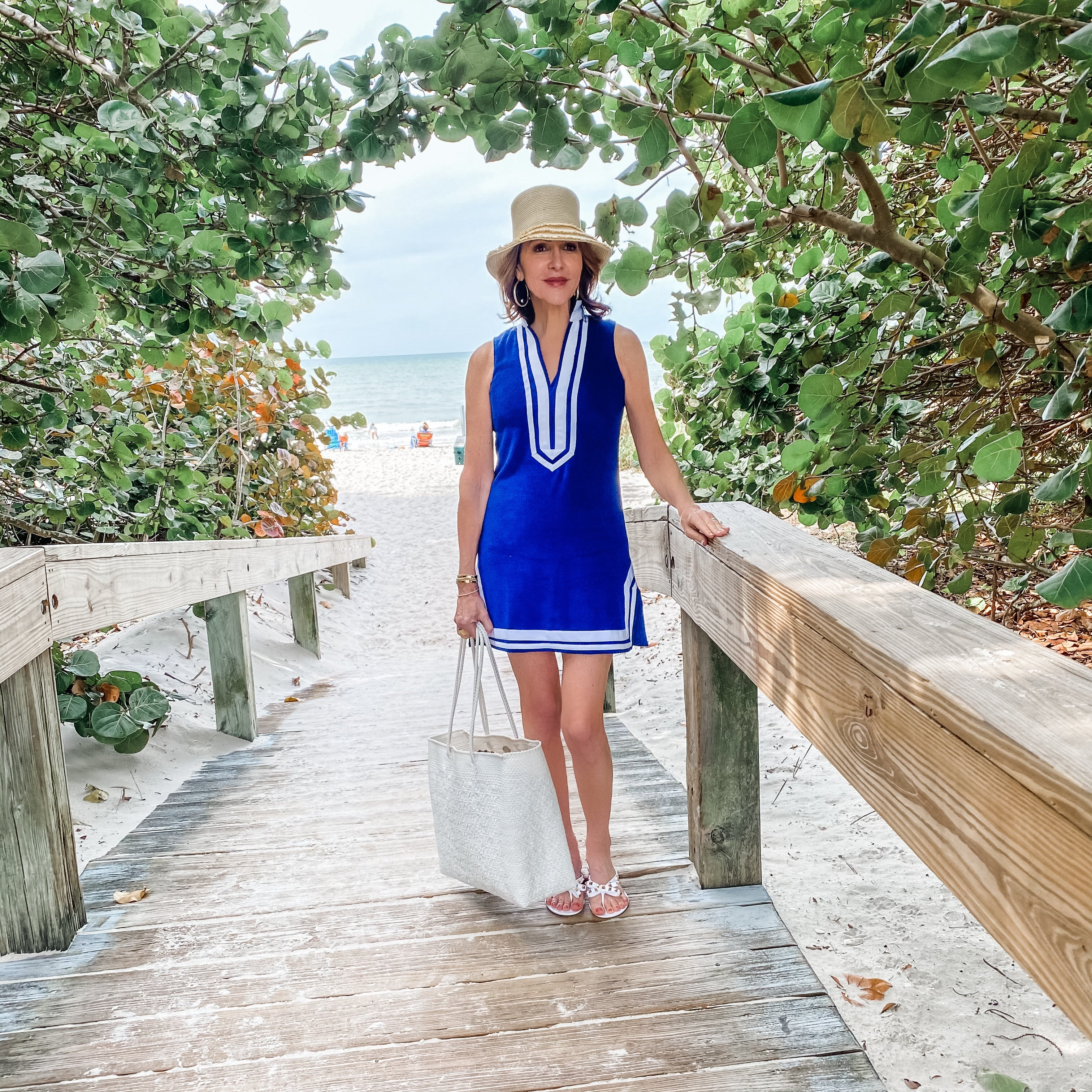 Woman on boardwalk to beach wearing Cabana Life Navy Sleeveless Terry Tunic