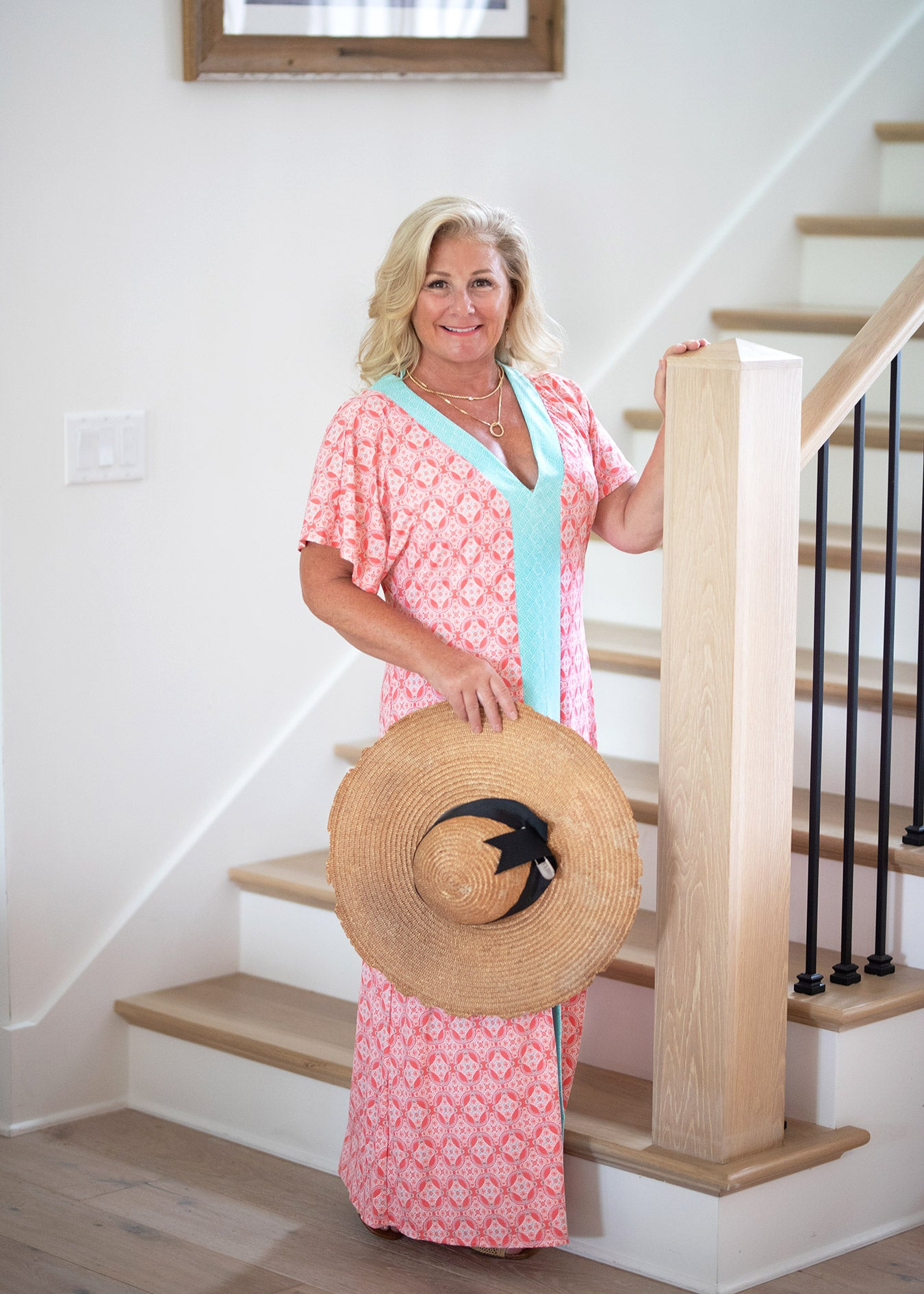 Mollie Spriggs wearing Cabana Life Coral Tides Maxi Dress