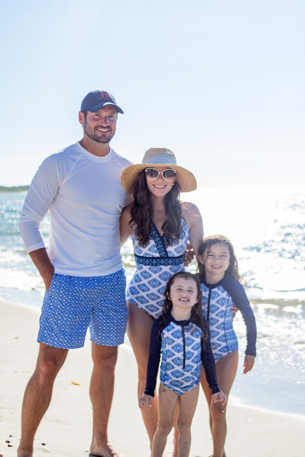 Caitlin Houston & family wearing family matching Batik swimsuits with UPF 50+ protection