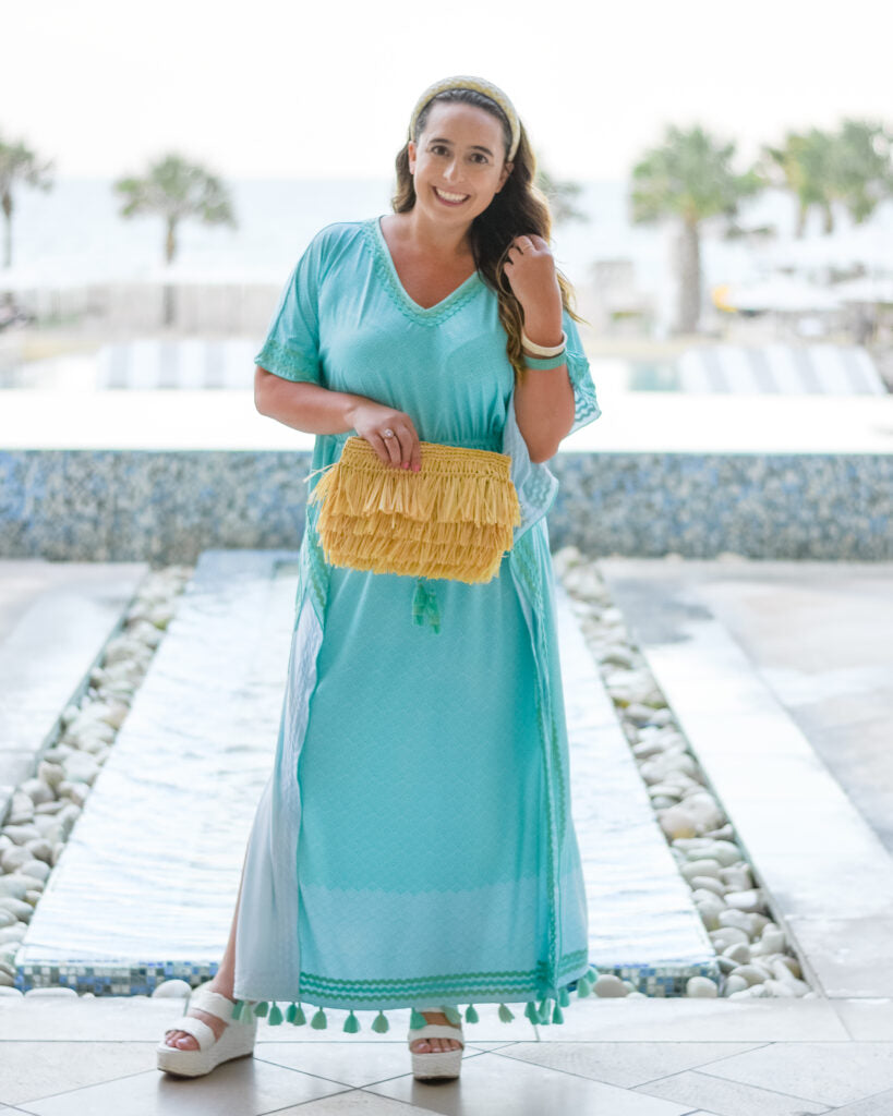 Woman wearing Cabana Life Coral Tides Tassel Tie Maxi Cover Up