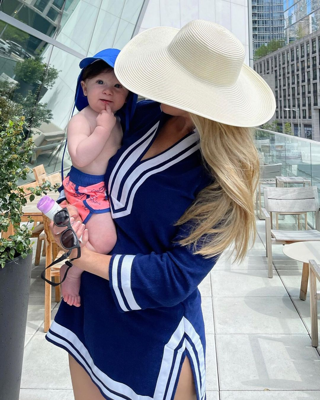 Woman holding baby and wearing Cabana Life Navy/White Terry Tunic