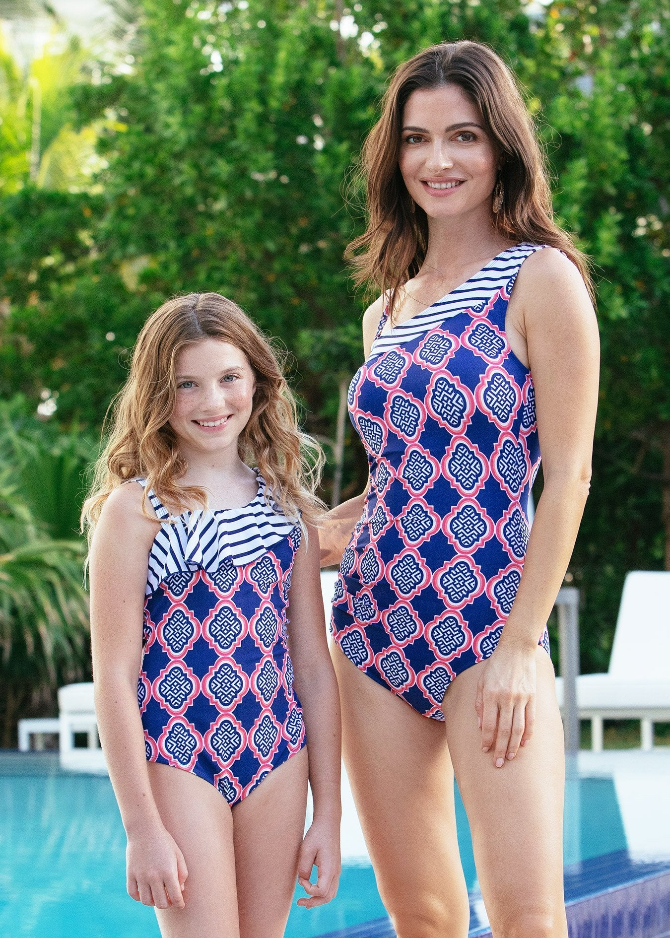 Woman and girl wearing Navy Geo One Piece Swimsuits with UPF 50+ sun protection