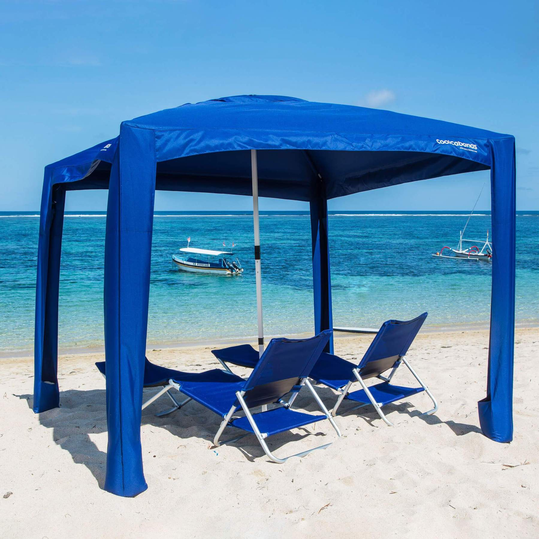 CoolCabanas | Cool Cabana 5 Solid Navy set up on beach with Set of 2 CoolCabana Beach Loungers underneath