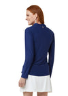 Woman wearing Navy Sport Zip Polo and White Classic Swim Skirt