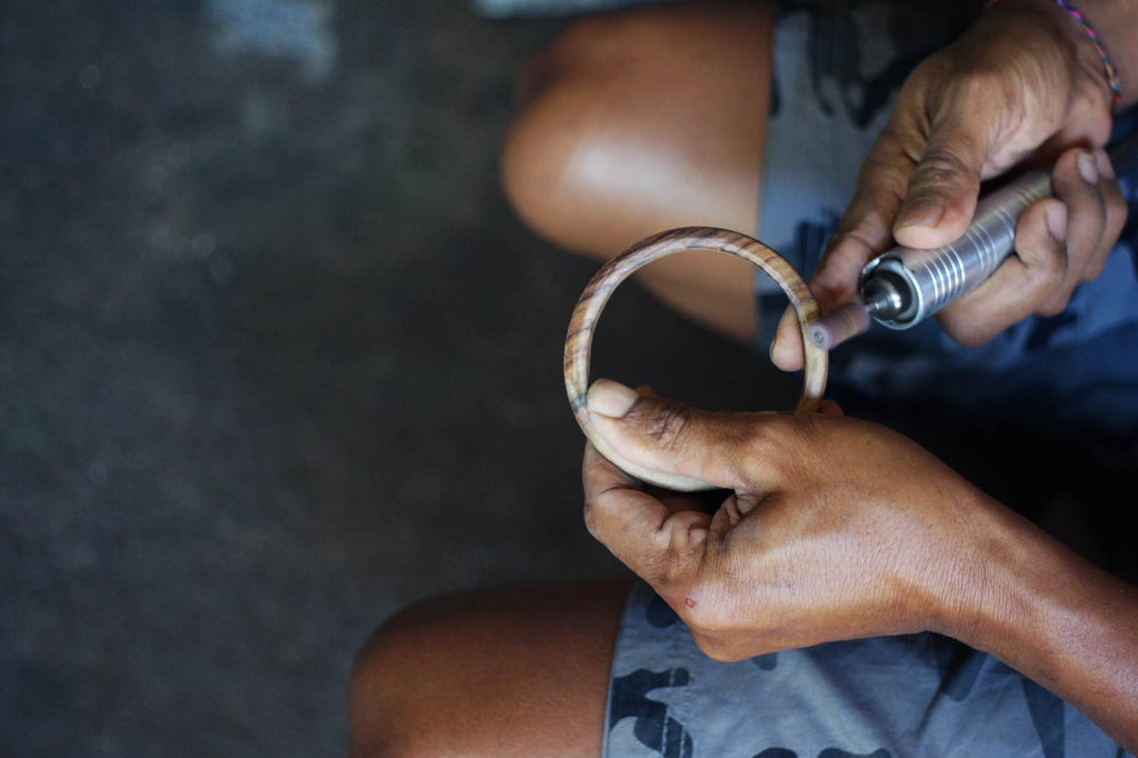 Pak Nyoman crafts the wooden ring