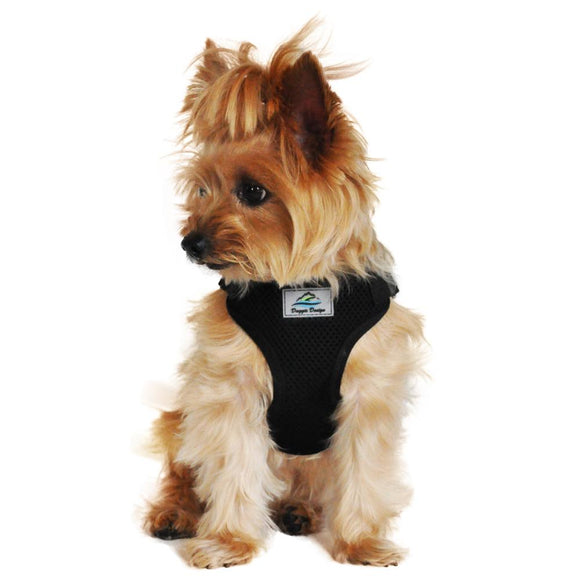 picture of a dog wearing a solid black cloth dog harness