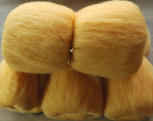 Hand carded Merino top dyed with Annatto and Soda Crystals