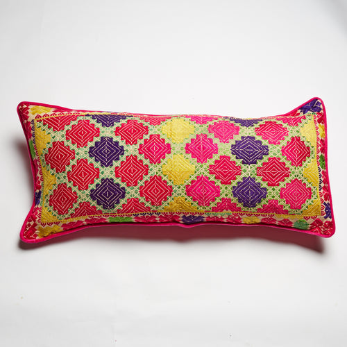 Bright, hand-embroidered silk cushion. Symmetric, geometric design. Pink, yellow, purple