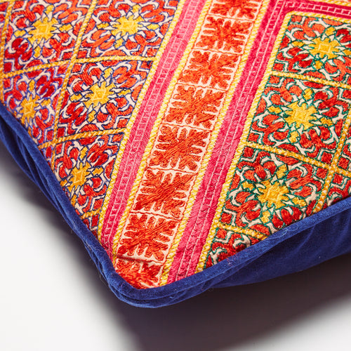 Detail shot of the hand-embroidered silk. Unique patterns in pink, red, orange and yellow
