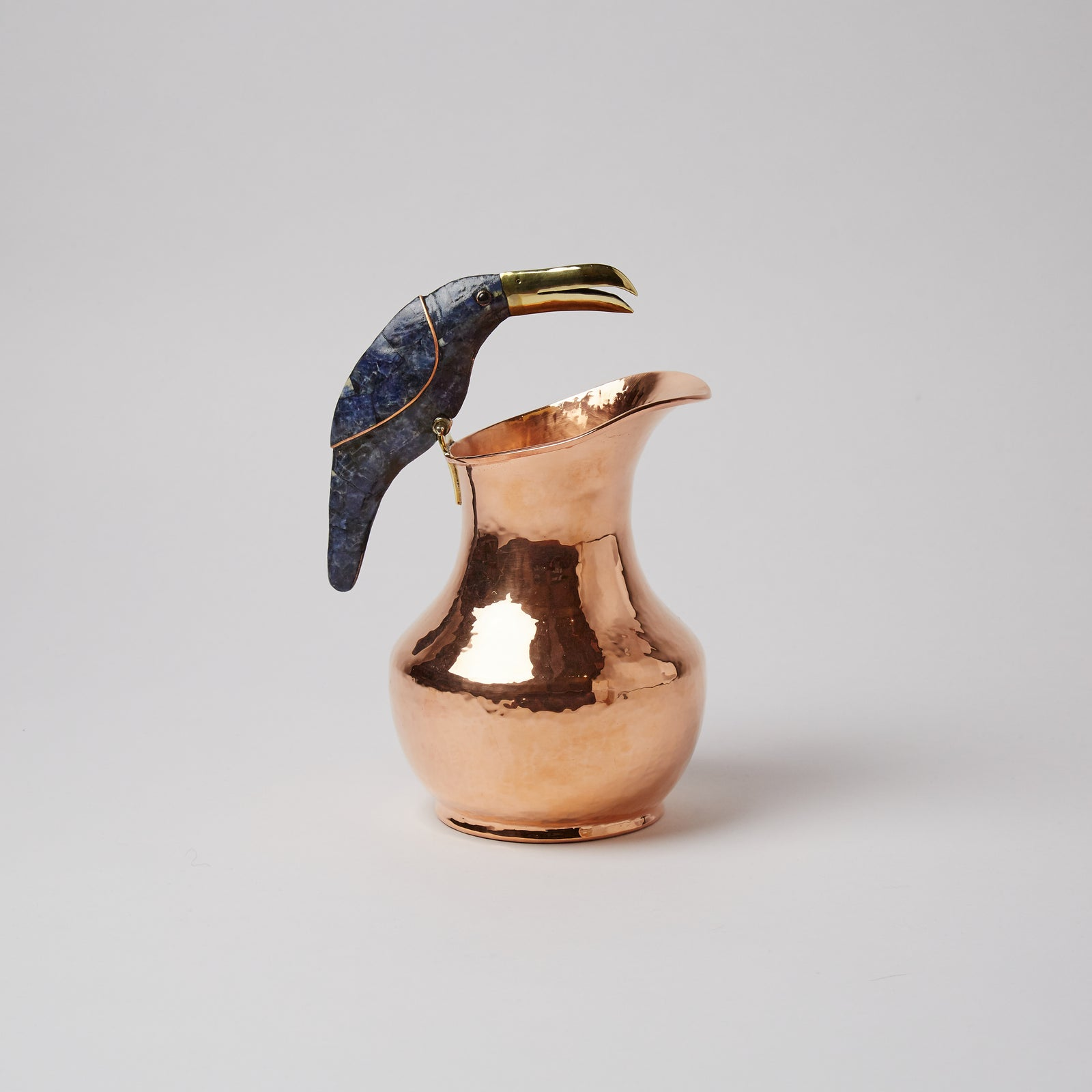 Copper jug, with toucan handle