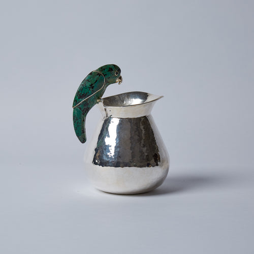 Bring the exotic to your table with this little green parrot cream jug.