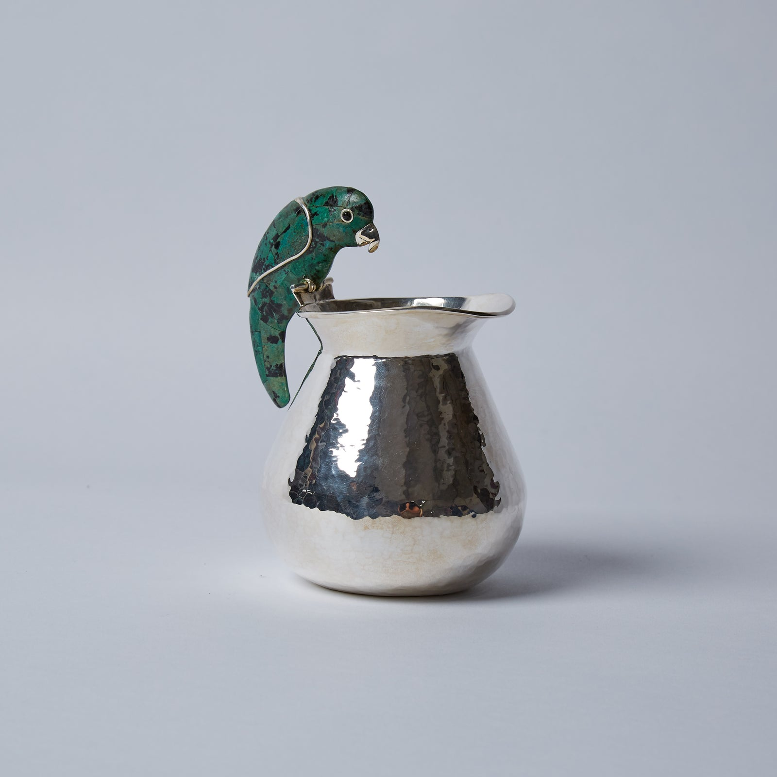 Carefully mosaicked in malachite, he can be paired alongside any of our sugar pots or other cream jugs for a talkative collection.