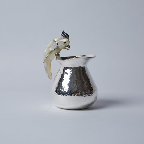 Delightful little cream jug with a cheeky cockatoo handle, mosaicked in Abalone Shell.