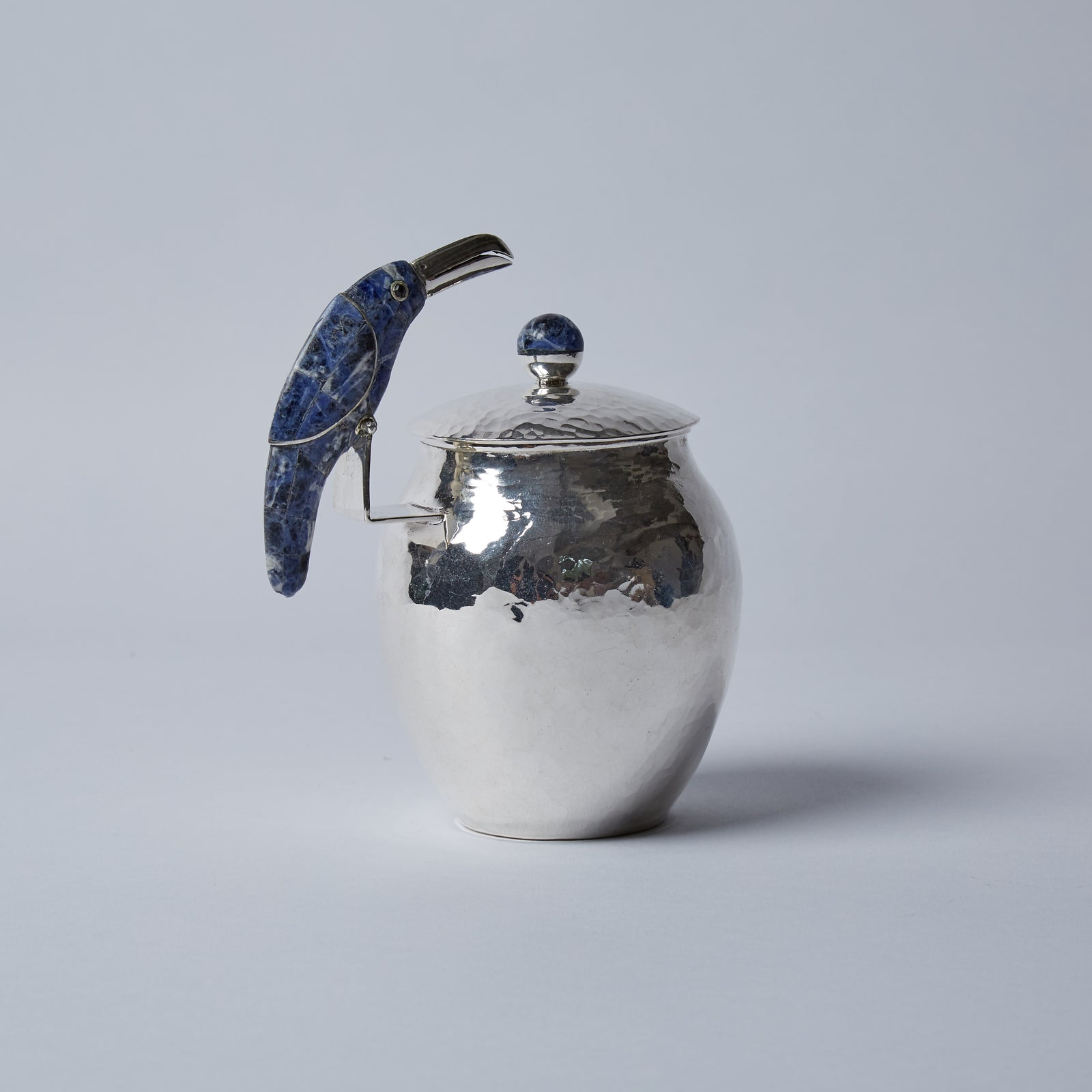This mischievous Toucan, mosaicked in Lapis Lazuli, is wondering if he can dip his elegant beak into the pot when you are not looking.