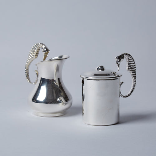A delicate sugar and cream set with delightfully inquisitive seahorses doubling as handles.