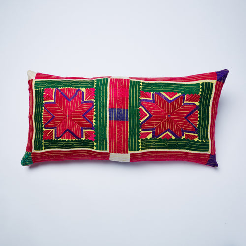 An exquisite piece, hand embroidered in silk over 70 years ago in the Swat Valley.  This exuberant textile has been carefully refashioned in the UK to produce a unique and special cushion which will stand out amongst its peers.
