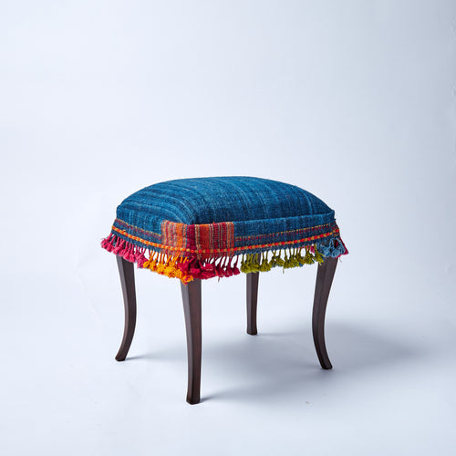 A handy and jolly little stool covered in one of our gorgeous hand-woven throws, with fabulous colourful fringe detail.