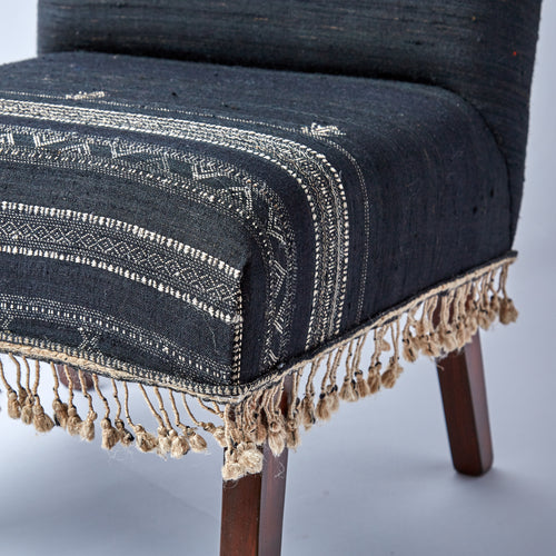 The intricate woven detail is enhanced by the flowing fringe.