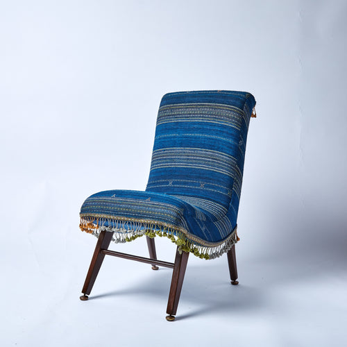 Fabulously comfortable vintage chair, reupholstered in one of our intricately hand-woven wool/silk blend throws.
