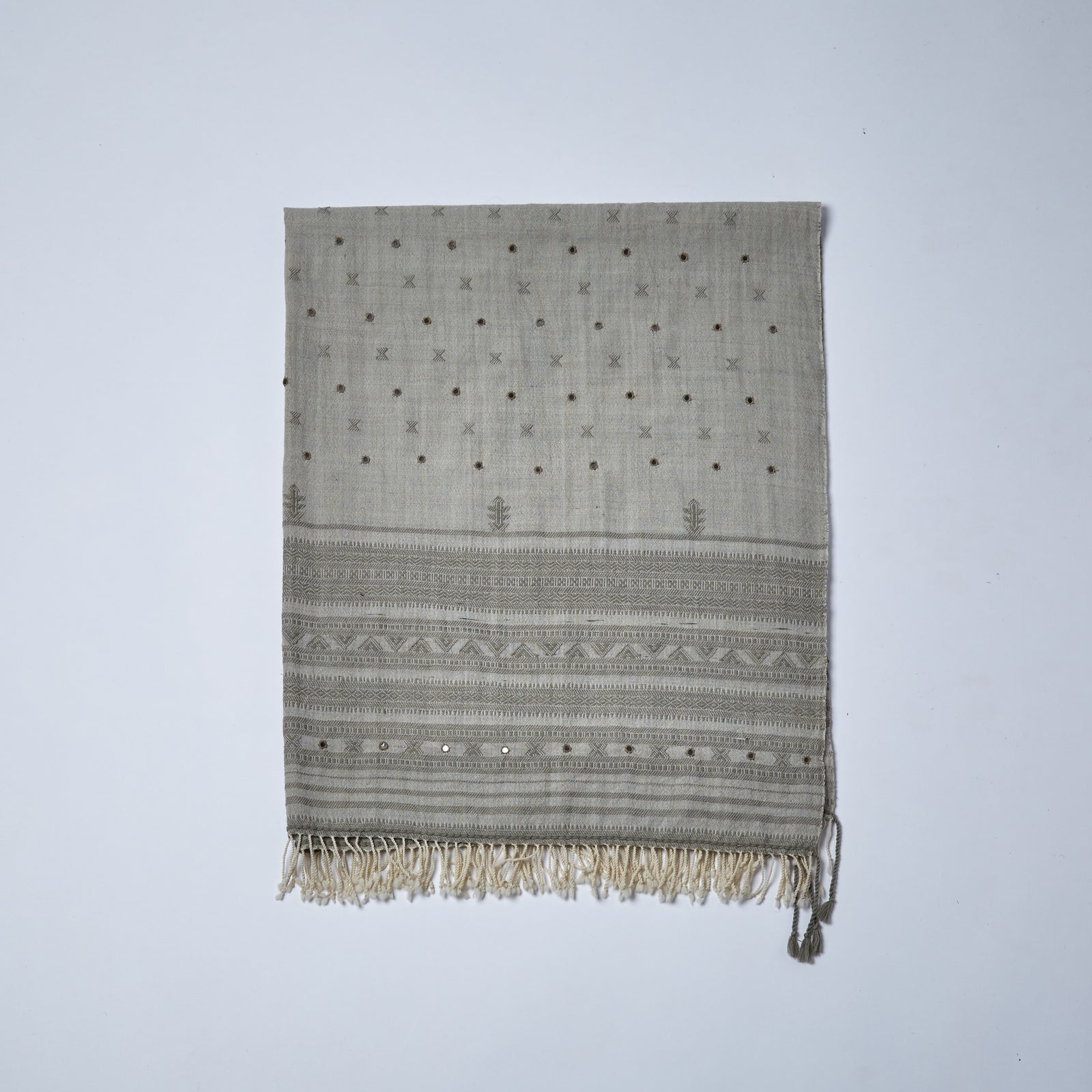 Merino Wool Shawl. Rajani has many similarities to her sister Pari, she is a shade paler but shares much of the the same style, with delicately stitched tiny mirrors adorning the fabric and beautiful hand woven motifs with linear designs at each end of the shawl.