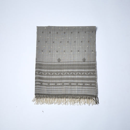 Merino Wool Shawl. This very elegant shawl is delicately enhanced by tiny mirrors stitched into the fabric with beautiful hand woven motifs and linear designs at each end of the shawl.