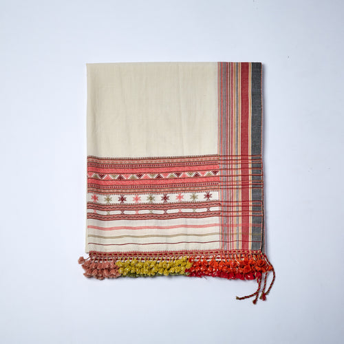 Merino Wool Shawl. This colourful traditional Kutchi shawl is one of our buyer's favourites. With an off-white base, the mix of pinks, corals and red details are completed but green, pink and red tassels.