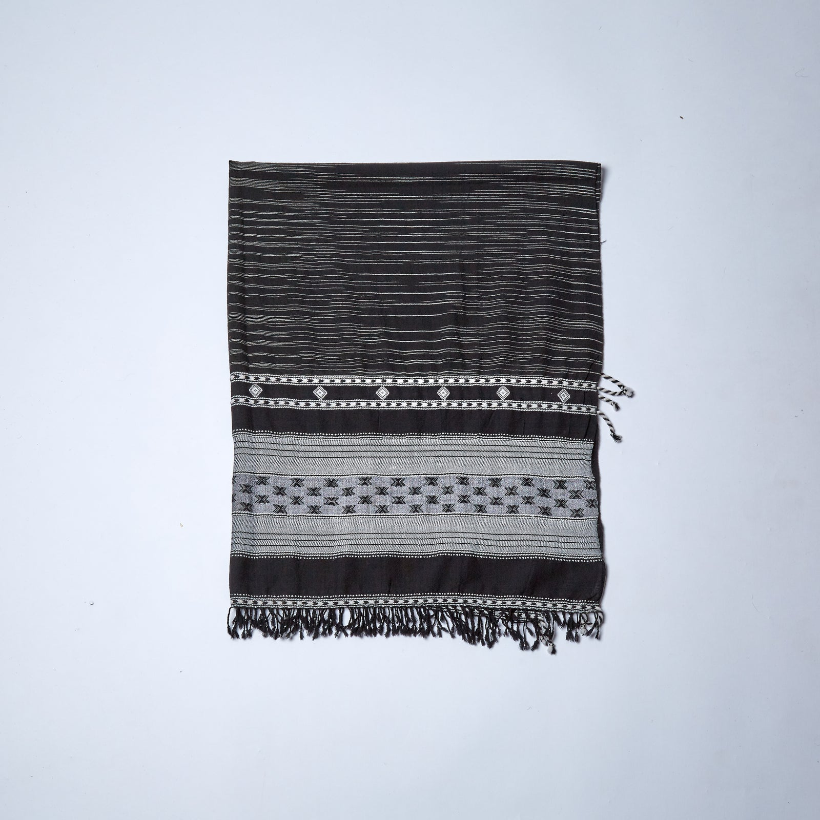 A black and white delight with traditional geometric design.  A go-to shawl for any occasion.