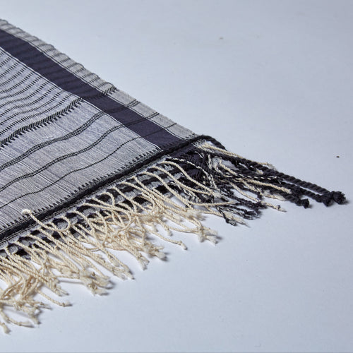 Lali is a super soft lightweight cotton shawl in classic navy blue and white, with linear, hand woven designs.
