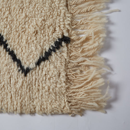 A traditional Berber tribal rug with its typically soft and cosy wool which demands that you bury your bare toes deep into its fibres.
