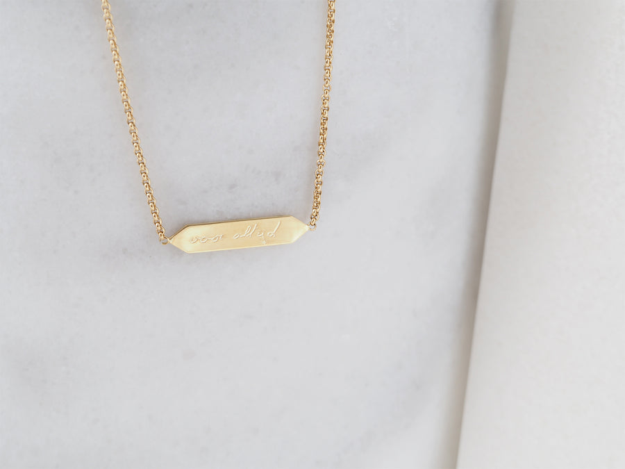 Shelter necklace with own writings/drawings