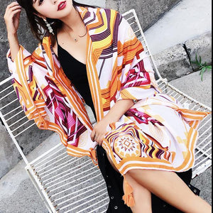Women orange print Vintage Buykud Seaside Vacation Printed Tassel Sunscreen Scarf