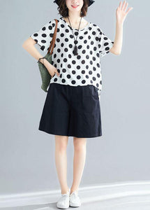 white dotted casual blended pullover and black elastic waist shorts