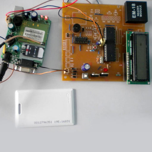 RFID cum GSM Vehicle Tracking System