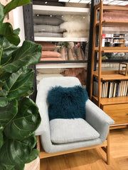 grey chair furry cushion