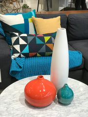Teal throw orange vase