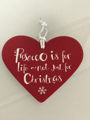 red ceramic hanging heart saying prosceeo is for life not just for Christmas