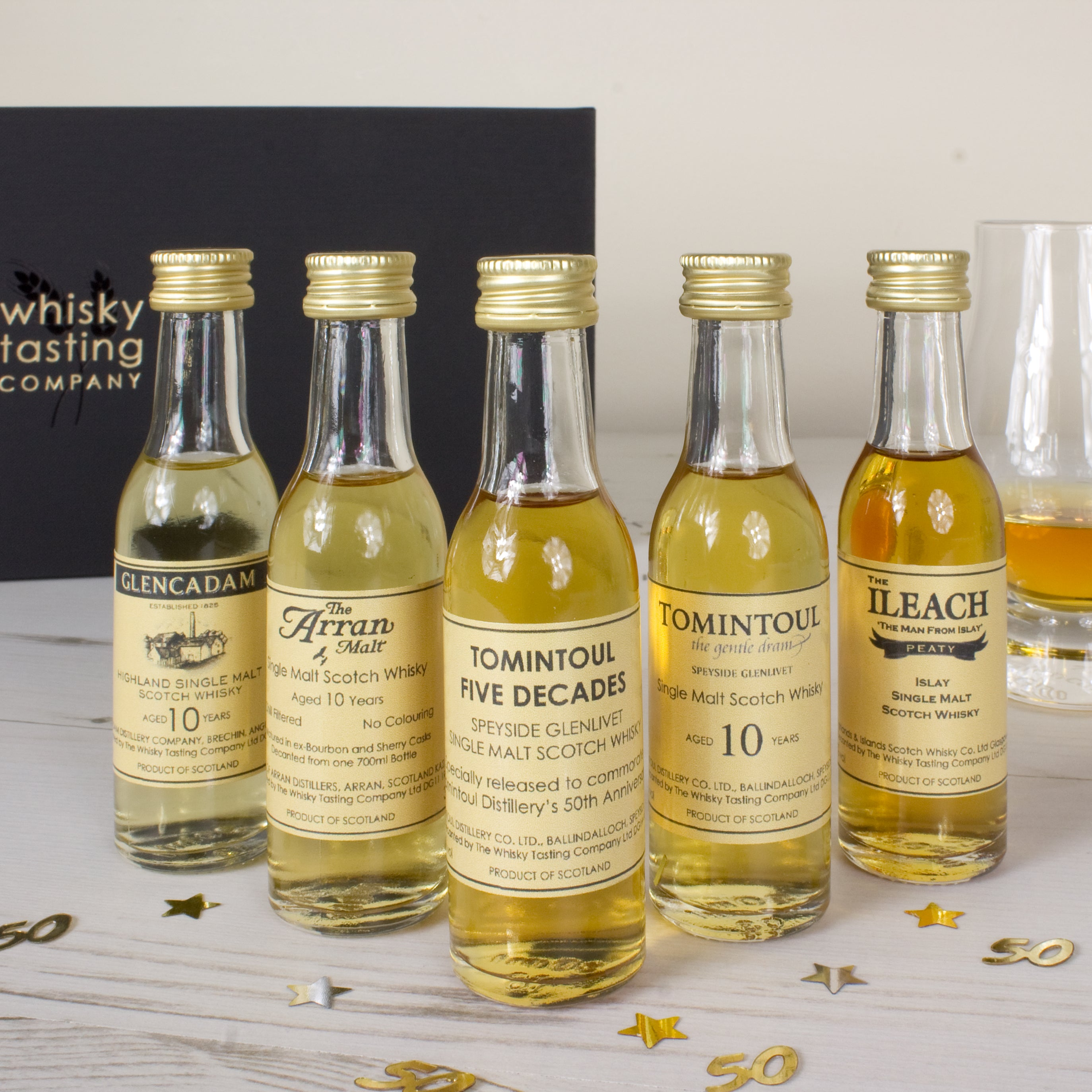 "50 year old birthday whisky gift set bottles - ""Five Decades"" Tomintoul Glenlivet single malt, Glencadam aged 10 years, The Arran Malt aged 10 years, Tomintoul aged 10 years and The Ileach Islay single malt."