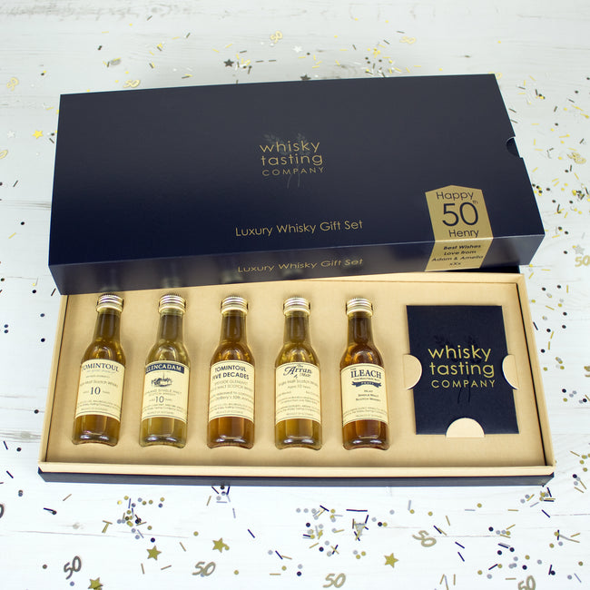 50 year old Scotch whisky and four single malt bottles whisky in personalised whisky gift set.  Personalised for 50th birthday.