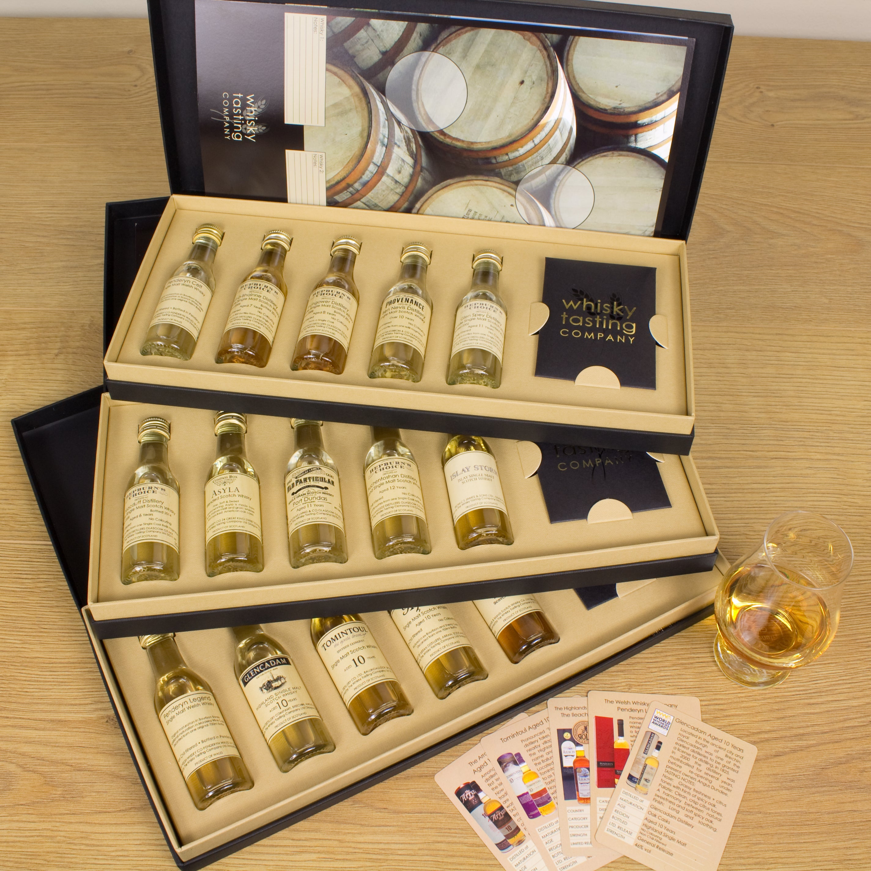 Single malt whisky gift subscription with individual tasting cards and a whisky tasting mat