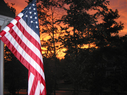 American Flag displayed and flown in front of home