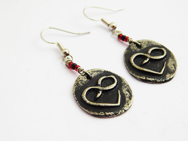 Infinity Heart Earrings Round Pewter with small seed beads. The beads are black and red. The Earrings hang approximately 2 inches long with silver wire.