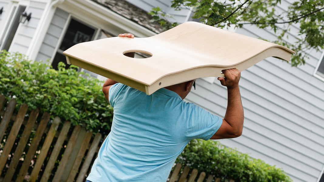Man carrying a Warphole™ board.